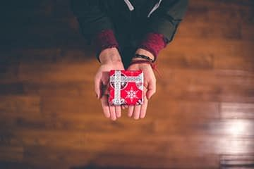 Stop giving out expensive gifts.